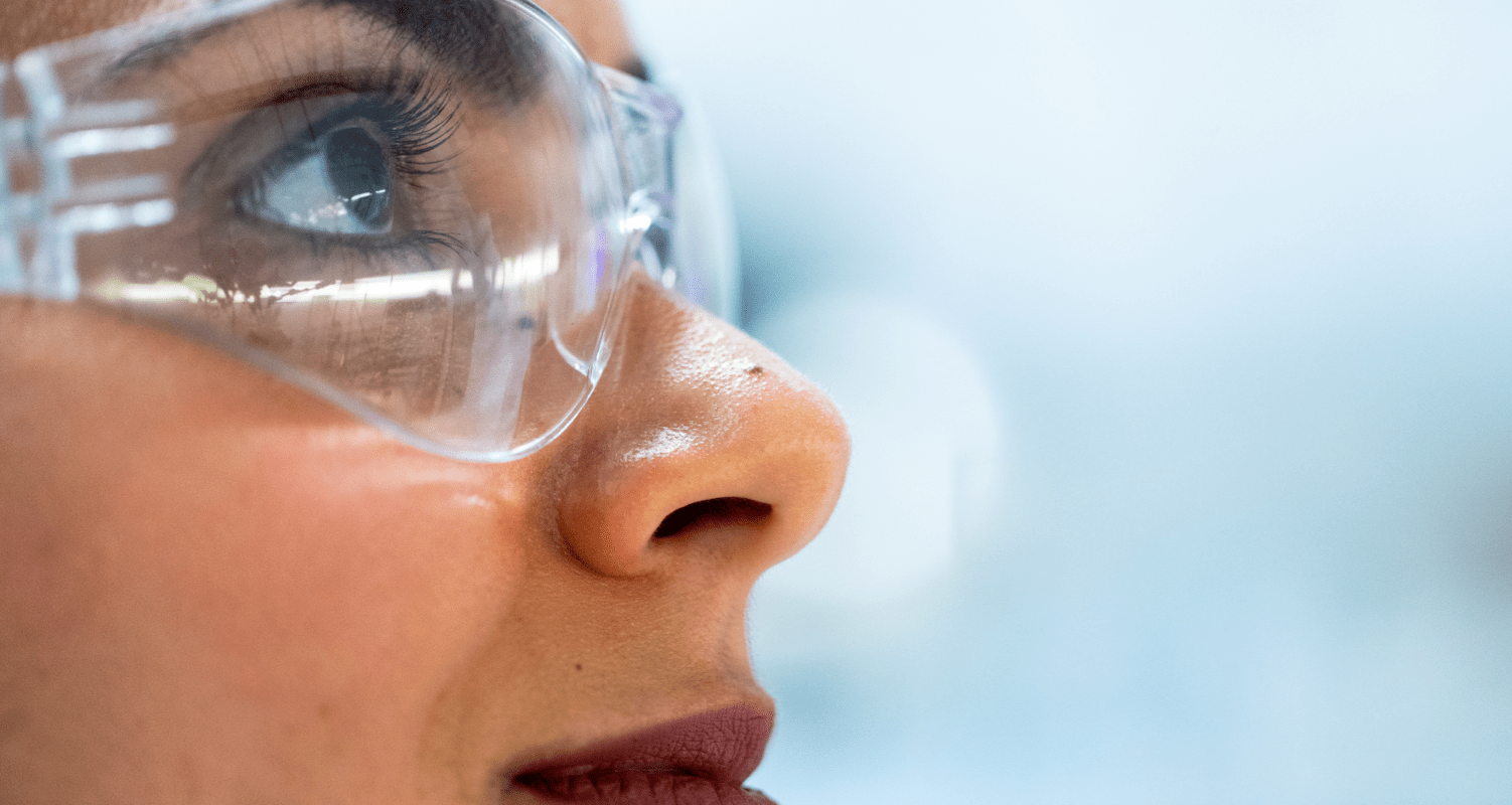 person looking upwards wearing goggles